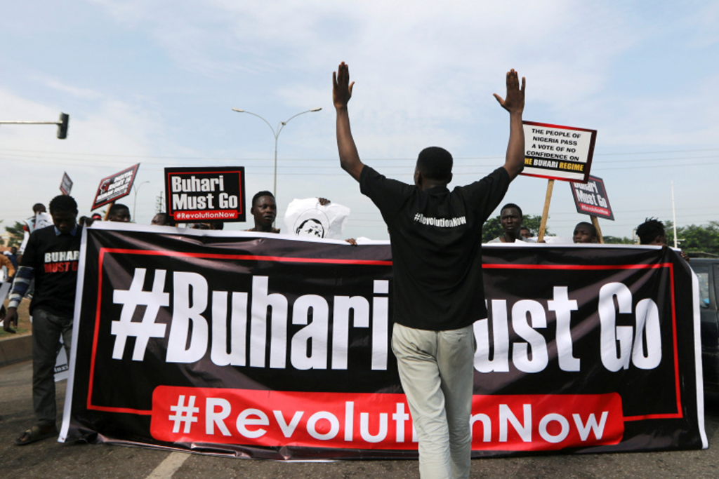 Demonstrators on Saturday carried a symbolic placard of President Muhammadu Buhari most go as protests exploded in Nigeria